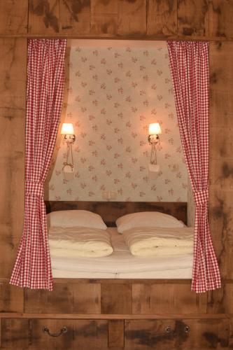 Een bed of bedden in een kamer bij Hof Kricheleberg