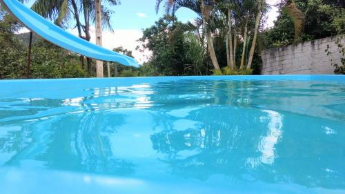 The swimming pool at or near chácara solar das águas