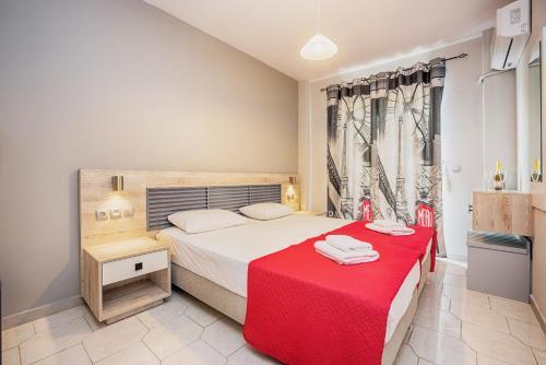 מיטה או מיטות בחדר ב-Maritina Apartments