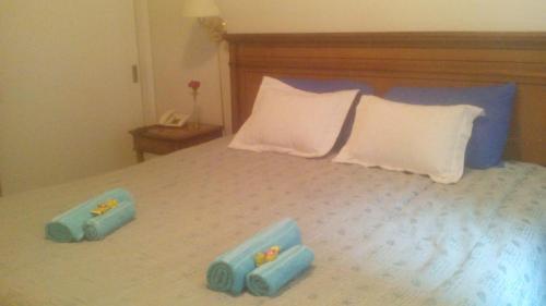 Una cama o camas en una habitación de Milenium suites. Avenida Bartolomé Mitre 753