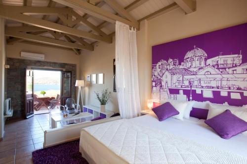 A bed or beds in a room at Angelina Boutique Escape