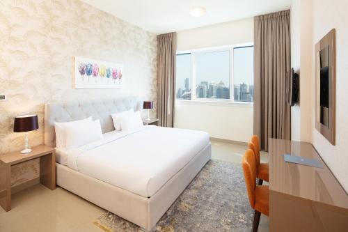 سرير أو أسرّة في غرفة في شقق مفروشة - بارسيلو للشقق الفندقية