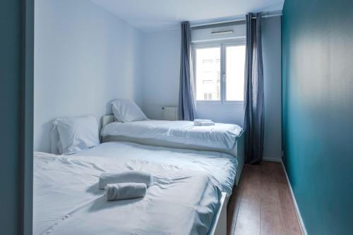 Cama o camas de una habitación en Standing apartment in Disneyland