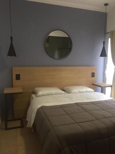 Una cama o camas en una habitación de Palo Santo Dptos.