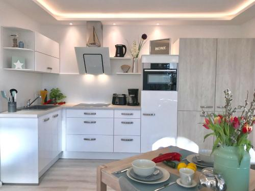 Kuchyň nebo kuchyňský kout v ubytování Villa Heinrich
