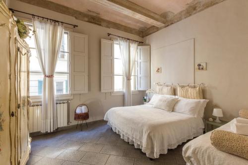 A bed or beds in a room at Casa Laura&Duccio