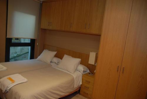 A bed or beds in a room at Apartamento Enol