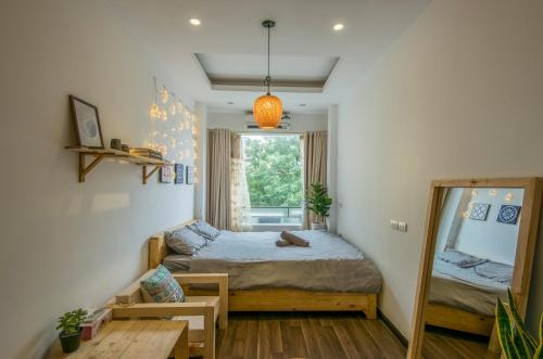 A bed or beds in a room at Joie Homestay Old Quarter Hanoi