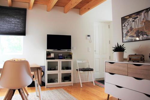 A television and/or entertainment center at Green House / Casa Verde
