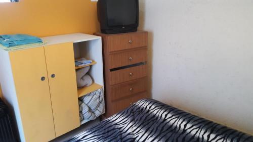 Una cama o camas en una habitación de Kaizen