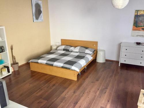 Ένα ή περισσότερα κρεβάτια σε δωμάτιο στο St Wenceslas Apartment