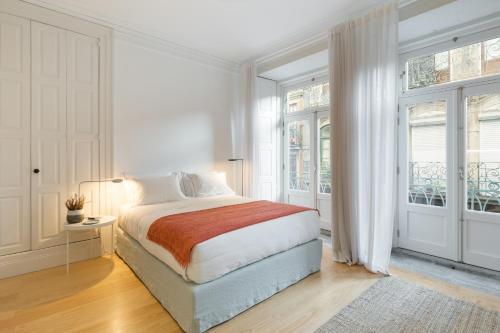 Uma cama ou camas num quarto em B28 Apartments Porto
