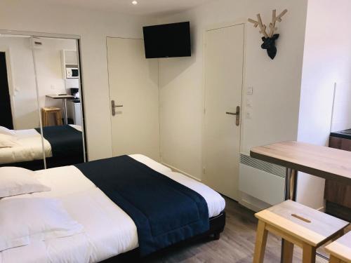 Un ou plusieurs lits dans un hébergement de l'établissement Hippotel
