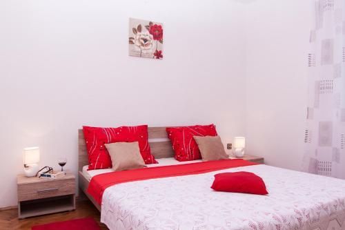 Ein Bett oder Betten in einem Zimmer der Unterkunft Nadalina Apartment
