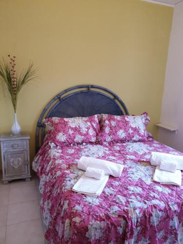 A bed or beds in a room at Vistamare La Fonte