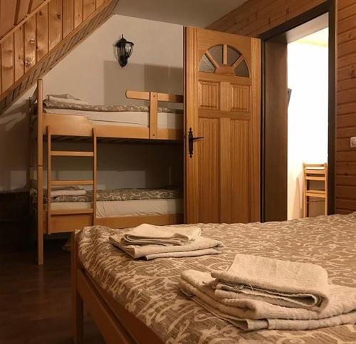 A bunk bed or bunk beds in a room at Villa Popara Kopaonik