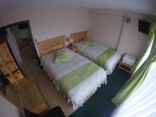 A bed or beds in a room at Almudena Apart Hotel
