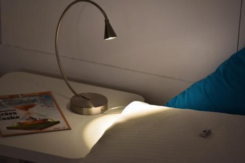 Ein Bett oder Betten in einem Zimmer der Unterkunft A. V. Pension Praha