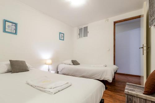 A bed or beds in a room at Lanui Belem Apartment