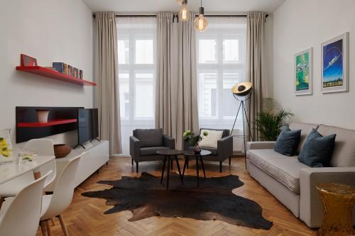 אזור ישיבה ב-Residence Vocelova