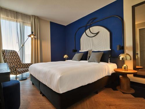 A bed or beds in a room at Cityden The Garden Amsterdam South