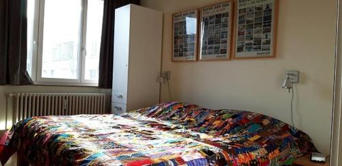 Un ou plusieurs lits dans un hébergement de l'établissement Appartement aan Zee Oostende