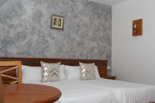 Apartamentos Gomila Park tesisinde bir odada yatak veya yataklar