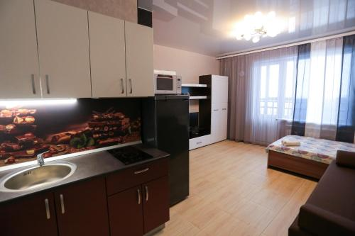 A kitchen or kitchenette at Апартаменты на Гоголя 26