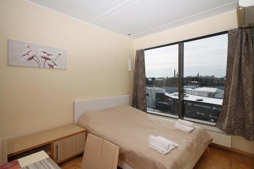 Vuode tai vuoteita majoituspaikassa Lootsi Evm Bee Apartment nean the port