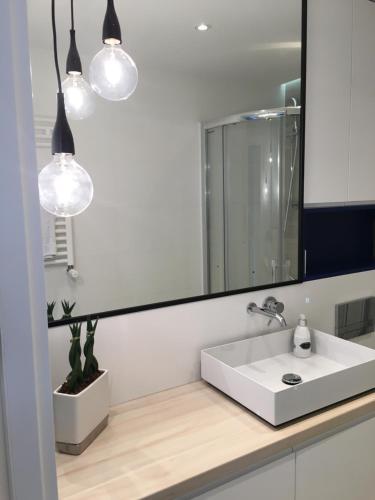 A bathroom at Apartament Leśne Tarasy