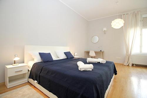 Posteľ alebo postele v izbe v ubytovaní Idealis