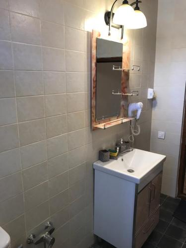 A bathroom at Hope Lake city Apartment