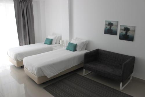 A bed or beds in a room at Parque dos Pastores