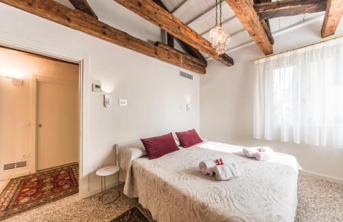 Letto o letti in una camera di BRUNILDA'S HOME