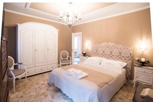 A bed or beds in a room at Venezia Ca' Drì Apartment