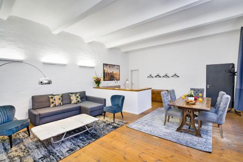A seating area at GreatStay Apartment - Melchiorstr.