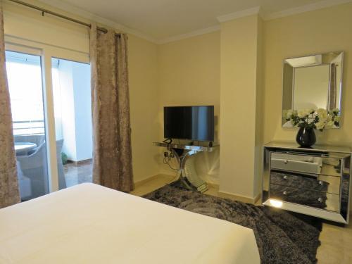 Cama o camas de una habitación en Terrazas de Banus Apartment