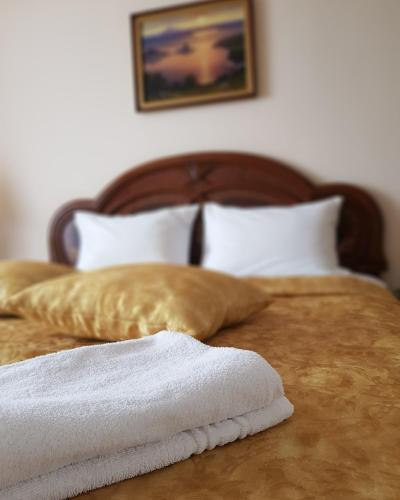 A bed or beds in a room at Petropavlovsk Hotel