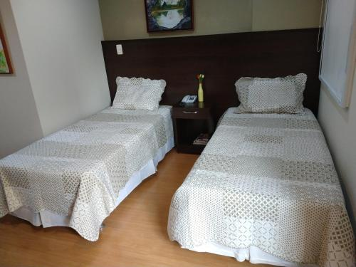 A bed or beds in a room at Apt Mont Blanc Apart Hotel 109
