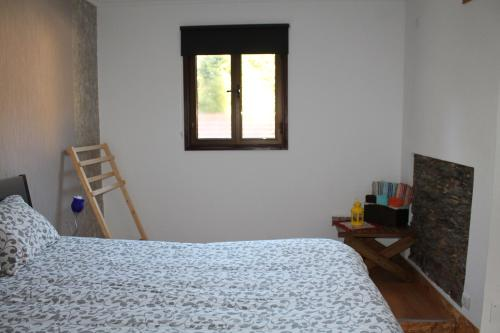 A bed or beds in a room at Canto do Melro