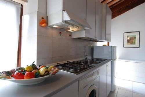 A kitchen or kitchenette at Palazzo Sant'Andrea ItalianFlat