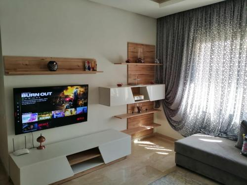 A television and/or entertainment center at Luxury résidence Taj Nouaceur