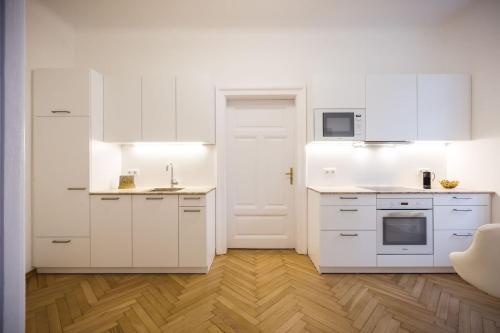 Küche/Küchenzeile in der Unterkunft Exclusive Apartment Così fan tutte