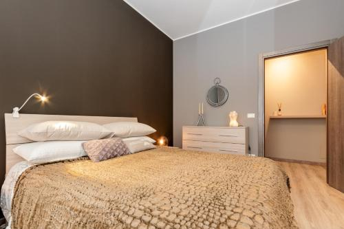 Letto o letti in una camera di Verona Borgo Roma Apartment