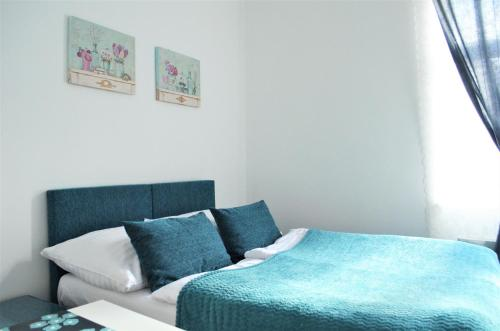 A bed or beds in a room at Apartments Soukenická