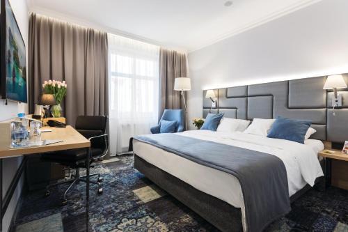 Een bed of bedden in een kamer bij Hotel Włoski Boutique Centrum Poznań
