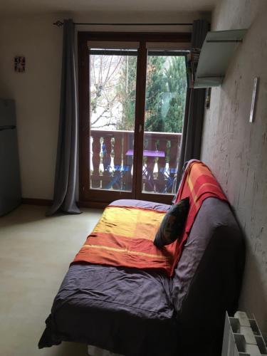Posteľ alebo postele v izbe v ubytovaní L'Appart D'Alice
