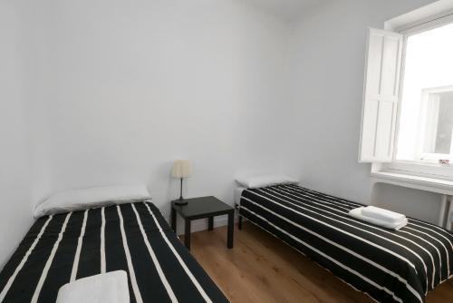 Ein Bett oder Betten in einem Zimmer der Unterkunft La Latina 2