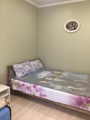 Кровать или кровати в номере Апартаменты на Самолете