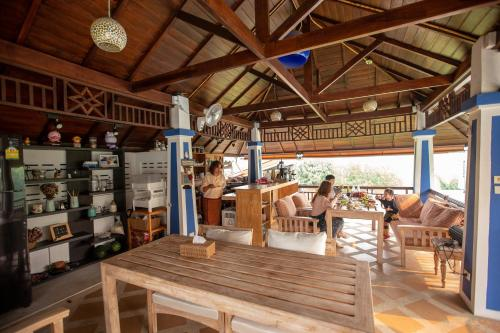 A restaurant or other place to eat at Baan Suksomboon by Pei Jing